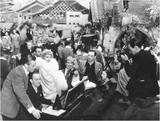 Robert Florey (third from right) on the set of Till We Meet Again