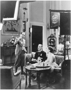 Sidney Franklin (standing) on the set of The Last of Mrs. Cheyney