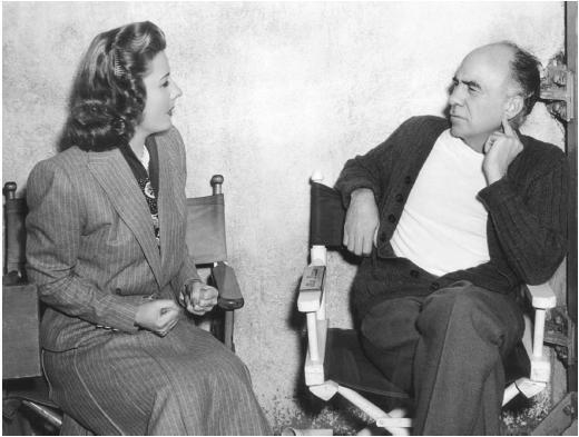 Gregory La Cava and Irene Dunn on the set of Unfinished Business