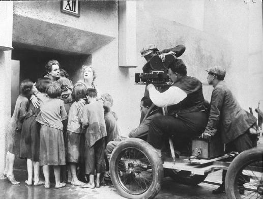Fritz Lang (seated below camera) on the set of Metropolis