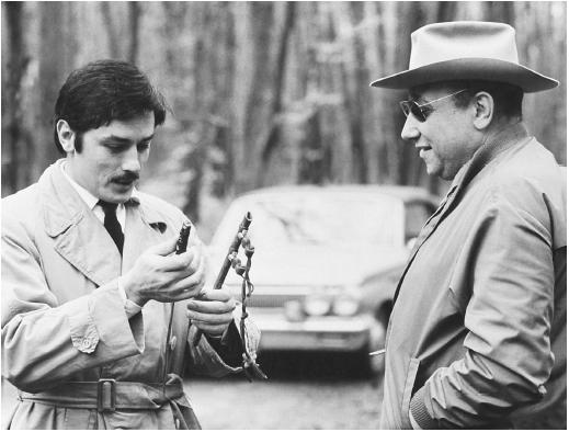 Jean-Pierre Melville (right) with Alain Delon