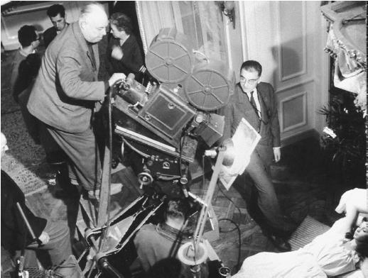 Jean Renoir (standing atop camera) on the set of French Cancan