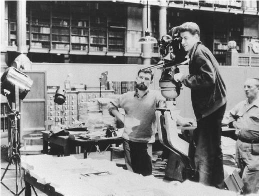 Alain Resnais (behind camera) on the set of Toute la mémoire du monde