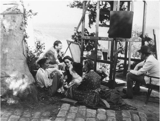 Mark Sandrich (sitting on ground by scaffolding), on the set of A Woman Rebels