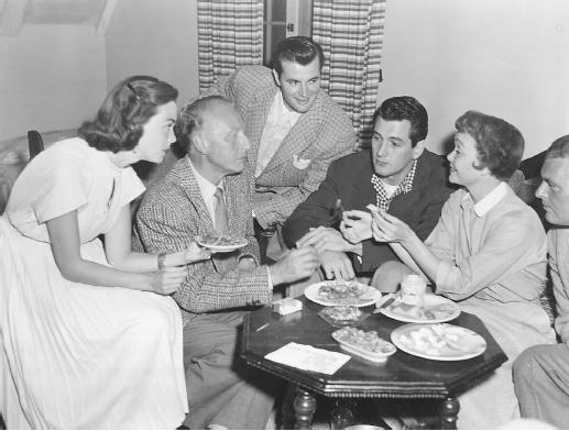 Douglas Sirk (second from left) with Barbara Rush, Jane Wyman, Greg Palmer, Rock Hudson, and R. Husson on the set of Magnificent Obsession