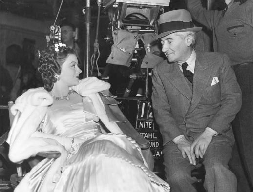 John M. Stahl and Myrna Loy on the set of Parnell