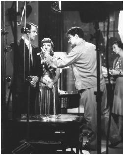 Preston Sturges (right) with Joel McCrea and Claudette Colbert on the set of The Palm Beach Story