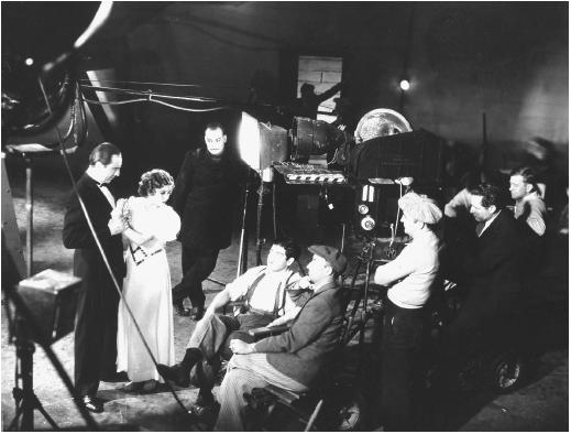 Edgar Ulmer (fourth from left) with Bela Lugosi (from left), Jacqueline Wells, Harry Cording, and John Mescall on the set of The Black Cat