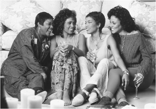Angela Bassett (second from right) with (l-r) Loretta Devine, Whitney Houston, and Lela Rochon in Waiting to Exhale