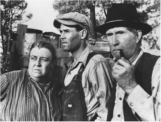 Henry Fonda (center) with Jane Darwell and John Carradine in The Grapes of Wrath