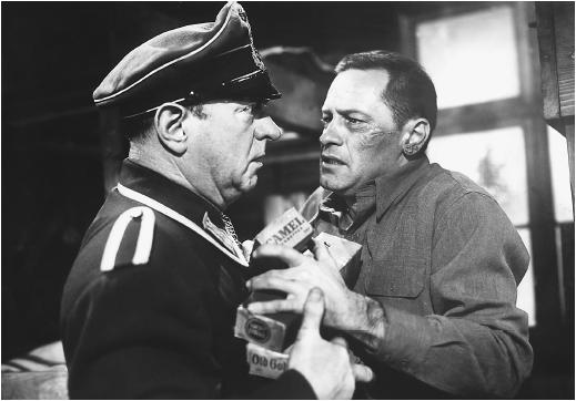 William Holden (left) with Sig Ruman in Stalag 17