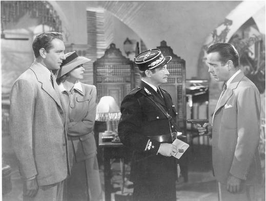 Claude Rains (center) with Humphrey Bogart (right) Paul Henreid and Ingrid Bergman in Casablanca