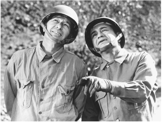 Edward G. Robinson (right) with Robert Mitchum in Mr. Winkle Goes to War