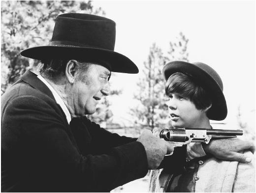 John Wayne (left) with Kim Darby in True Grit