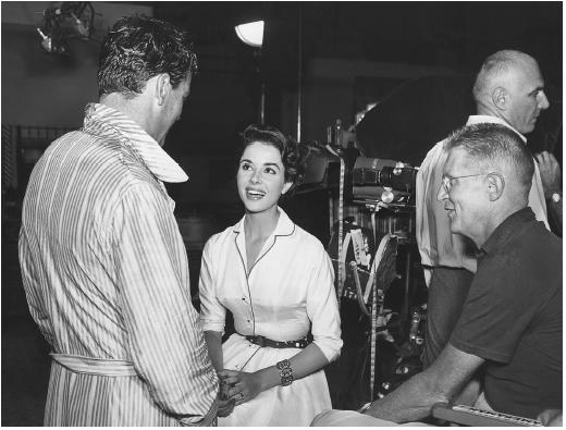 Philip Dunne (foreground) with Richard Egan and Dana Wynter