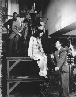 Joseph Walker (left) with Rosalind Russell and Alexander Hall